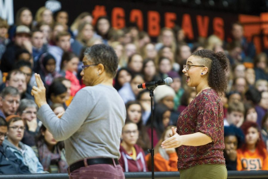 Junior WGSS major Sierra Lantz speaks Monday evening in Gill Coliseum about her experiences with racial intimidation in the classroom at Oregon State University.
