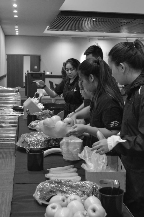 Staff members of the Global Community Kitchen prepare food for the Martin Luther King Jr. Peace Breakfast on Saturday, Jan. 24. The GCK allows student organizations to rent out the industrial kitchen in the Memorial Union to make food for campus events. Student volunteers prepare, serve and clean up the food through the GCK.