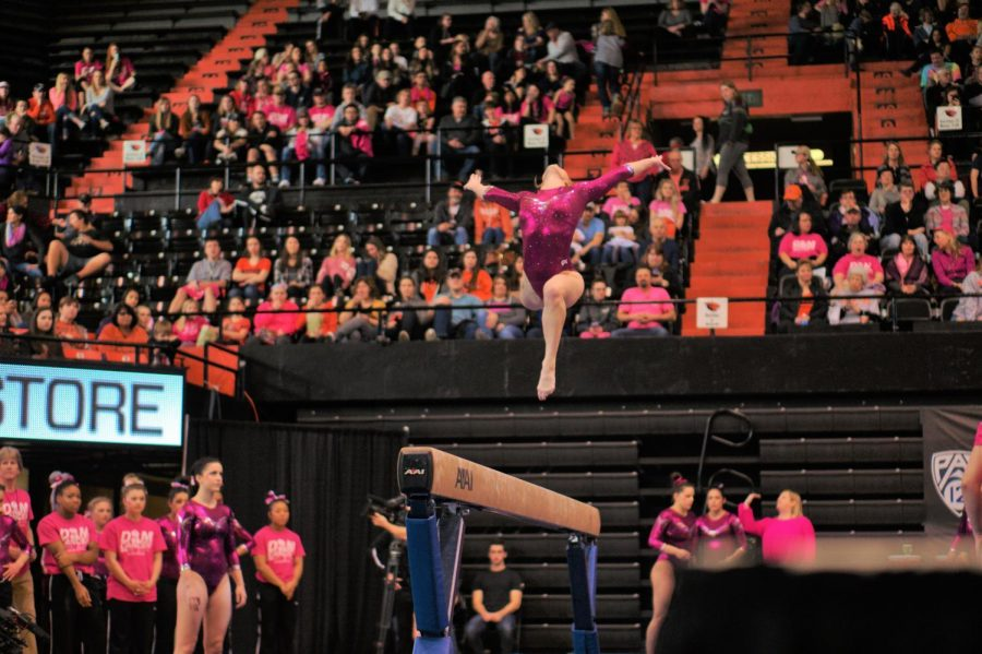 Senior Madeline Gardiner leaps on the balance beam during the Beavers upset of No.4 Utah.