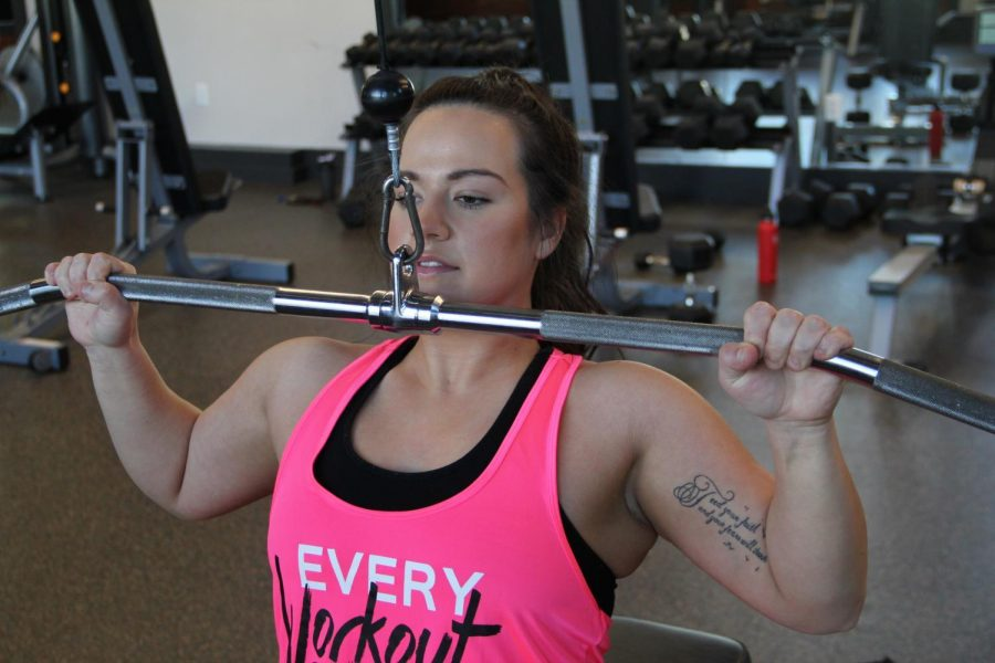 Elysha Lang works out at Dixon Recreaction Center. Lang uses her own personal experiences to teach students how to be healthy through training.
