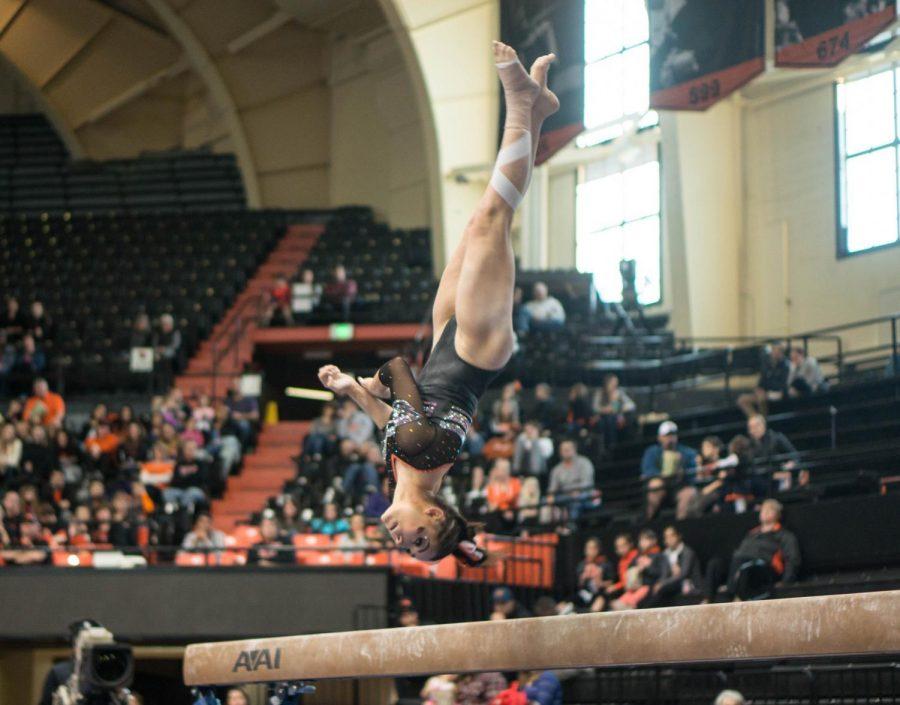 Sabrina Gill dismounts off the balance beam in Oregon States victory over Washington