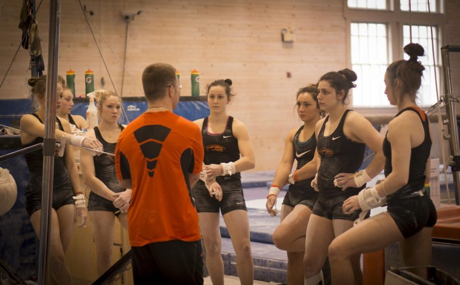 Assistant coach Brian Amato talks with the Oregon State gymnists