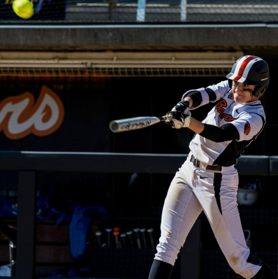 Softball player Shelby Weeks hits the ball. Weeks wears a wristband to honor her father, who lost his battle with cancer.