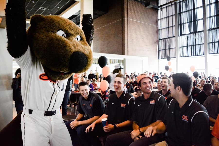Benny the Beaver accompanies baseball players Trevor Larnach, Mitchell Verburg, Jack Anderson and Grant Gambrell (left to right) as they wait to learn who their opponents will be in the upcoming NCAA tournament. The watch party took place at the Club Level of Reser Stadium Monday morning.