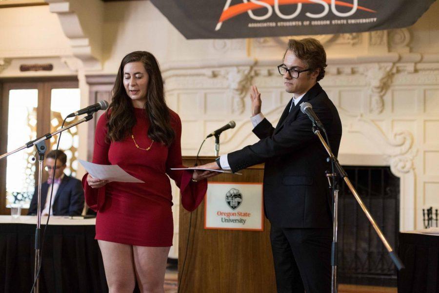 (Left) Rachel Grisham, 2016-17 ASOSU president, swears in Simon Brundage, 2017-18 president (right), during the inauguration.