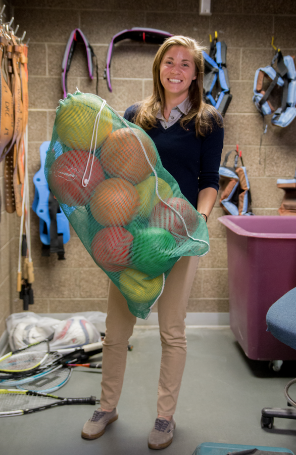 Sam Rodenberg, coordinator for sports program, holds a bag of dodgeballs in her hand. Rodenberg, along with the Department of Recreational Sports, works to give opportunities for students to engage in recreational activities.
