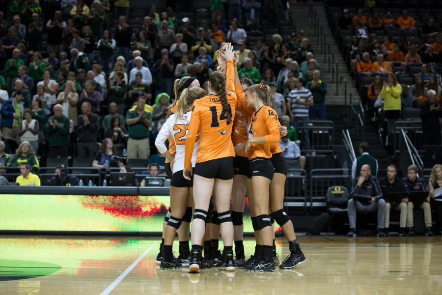 The OSU volleyball team in a pre-game huddle in an earlier match up against rival Universityof Oregon. OSU has won their past four conference match ups.