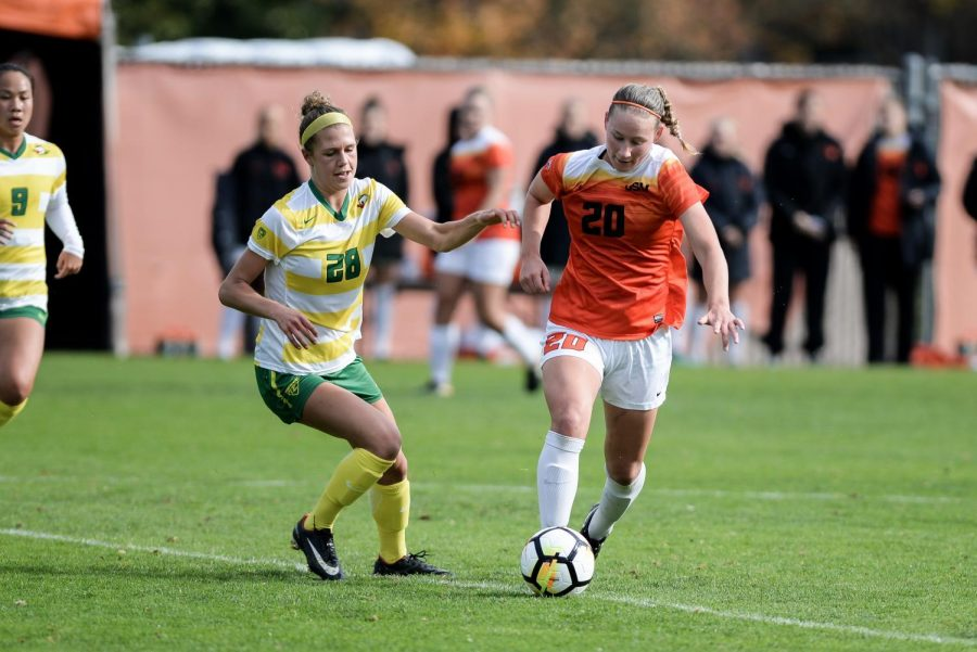 Beavers midfielder Nicole Nickerson dribbles up the field during the women's last soccer game of the season Thursday, Nov.2.