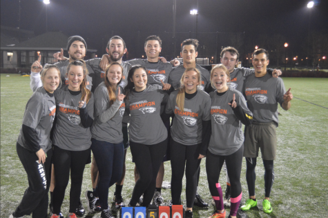 Co-rec champions Total Flag Football poses following their overtime victory against Varsity House to close out the fall 2017 intramural flag football season.
