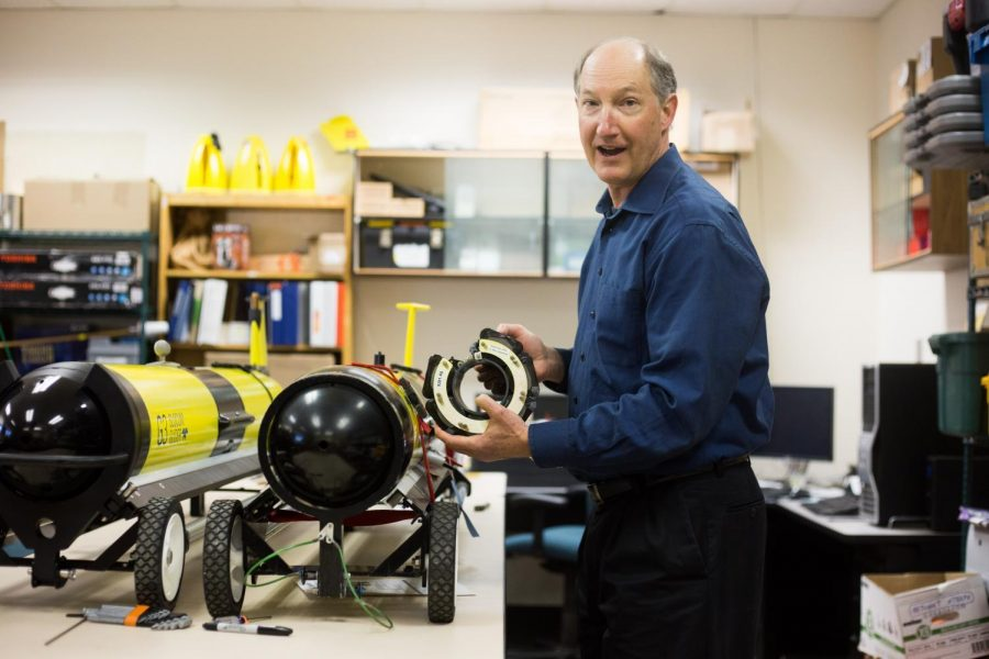 Dr.+Jack+Barth%2C+executive+director+of+the+Marine+Studies+Initiative+and+professor+at+OSU%2C+handling+one+of+the+battery+packs+that+the+UAS+gliders+utilize+to+power+their+sensors+and+adjust+theirdiving+patterns.