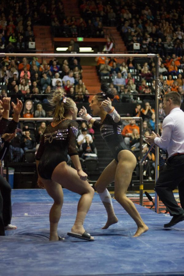 Sophomore Sabrina Gill celebrates with teammates during the meet. Gill was OSU's only all-around performer as one of her teammate was limited due to an illness.