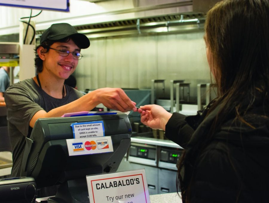 Calabaloo%E2%80%99s+student+worker+Luis+Roberts+taking+food+payment+from+Brooke+Sorenson%2C+first+year.%C2%A0
