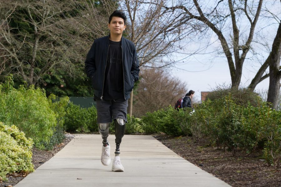 LBCC+student+Aaron+Ojeda+walking+across+campus.+Ojeda+lost+his+legs+and+parts+of+his+fingers+due+to+a+Meningococcal+B+infection+in+2014.+Ojeda+is+currently+a+third+year+graphic+design+student+at+LBBC%2C+and+pursues+his+passion+of+DJing+during+this+free+time.