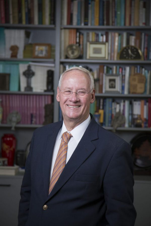 Oregon+State+University+President+Emeritus+Ed+Ray+smiles+in+his+office.+Ray+became+the+19th+president+of+OSU+in+2003.%C2%A0