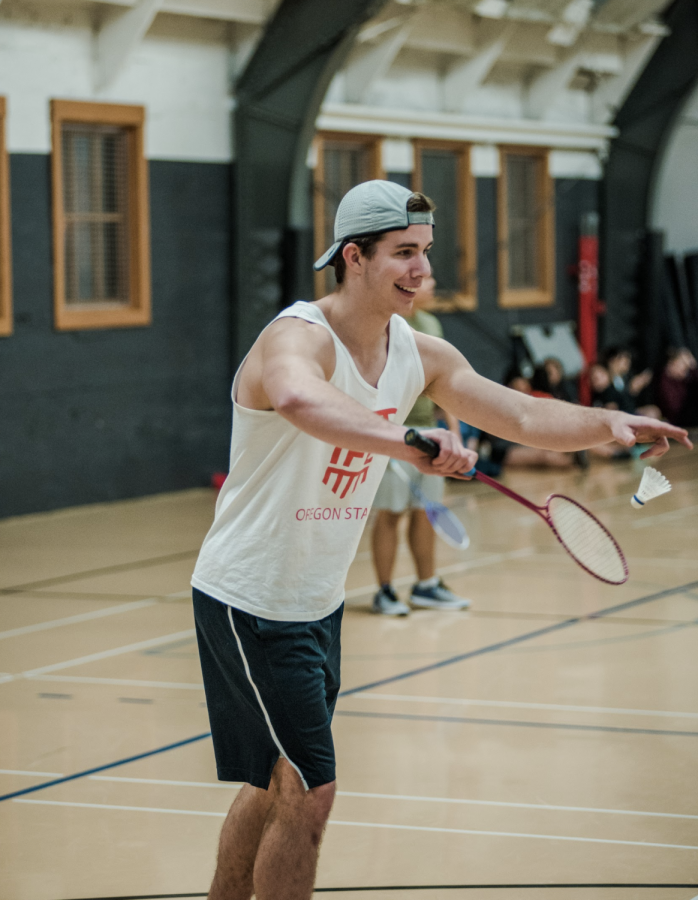 Student Lucas Rodgers competes in the badminton tournament. Champions were crowned in the CoRec, women's and men's divisions.