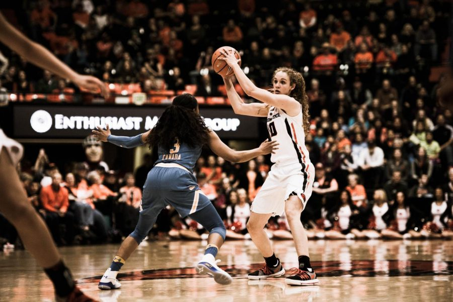 Junior+guard+Katie+McWilliams+looks+for+an+open+pass+at+the+top+of+three+point+line.+McWilliams+had+sixteen+points%2C+five+rebounds+and+four+assists+against+UCLA.