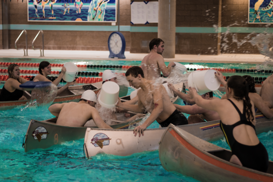 Teams attempt to sink other boats in the pool. Team Presentation Support ended with a victory.