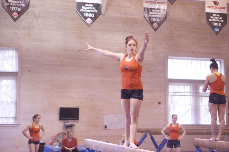Taylor+Ricci%2C+a+current+OSU+student+and+former+OSU+gymnast%2C+practices+high+beam+during+a+gymnastics+practice+in+Gladys+Valley+Gymnastics+Center.