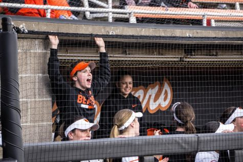 Members of the Beaver softball team watch this weekends series from the dugout.