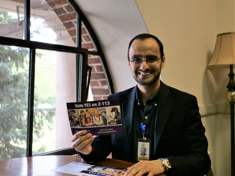 Sami Al-Abdrabbuh, Corvallis School Board vice chair, holds up promotional material for Measure 2-113. The measure is part of the May 15 election for residents in Linn and Benton Counties.