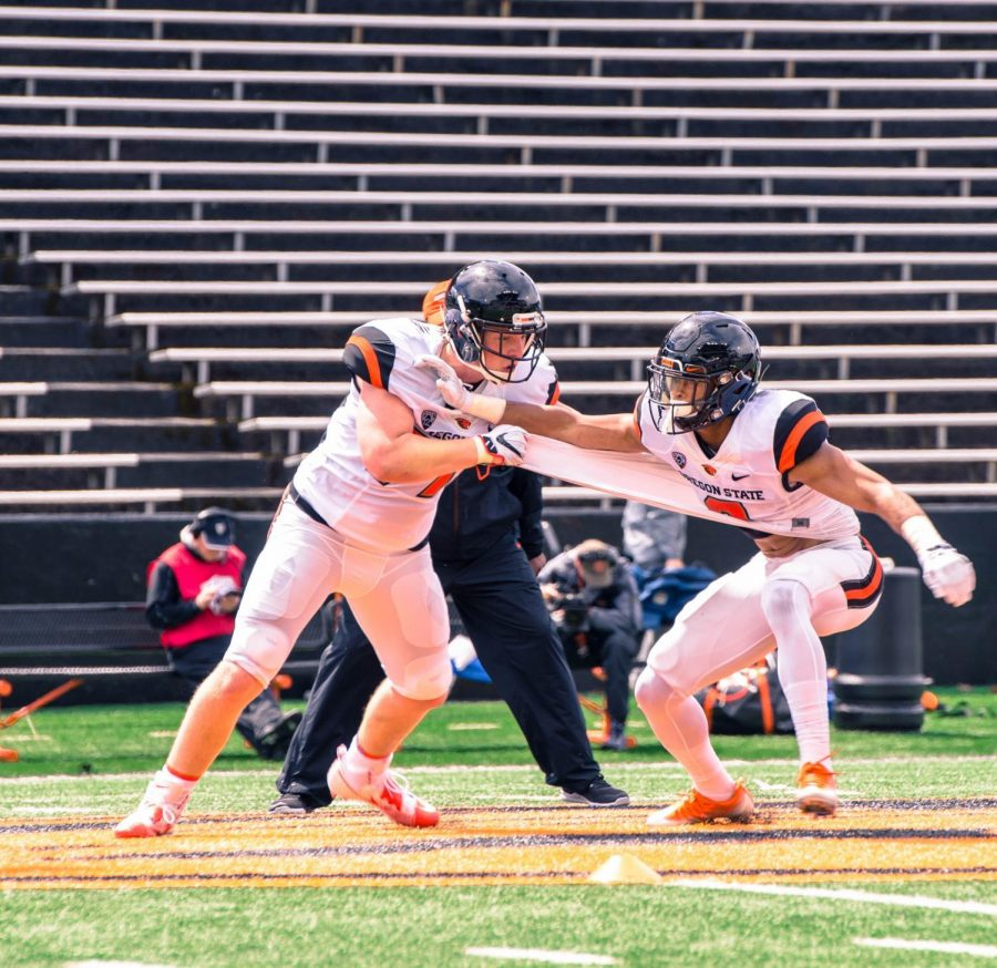Two+Oregon+State+football+players+scrimmage+during+the+spring+game+April+28+at+Reser+Stadium