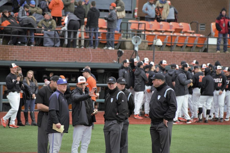 Beavers+baseball+head+coach+Pat+Casey+stands+with+the+University+of+Washington+head+coach+Lindsay+Meggs+to+discuss+the+game+with+Pac-12+baseball+officials.