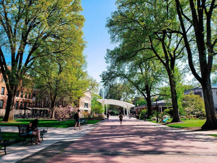 Students+enjoy+the+spring+weather+near+the+OSU+brick+mall%2C+looking+south+at+the+Student+Experience+Center+Plaza%2C+on+Thursday%2C+April+26.