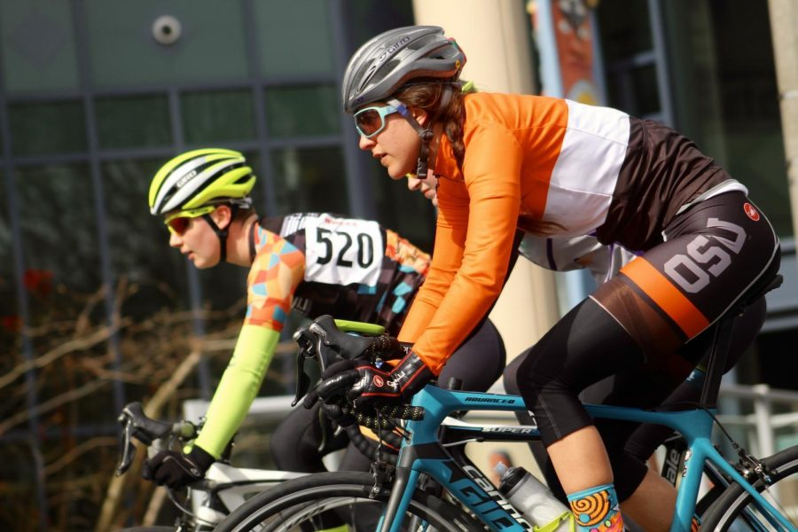 Cyclist+Victoria+Jansen+races+against+an+opponent+in+the+Womens+A+Criterium+at+WWU+in+Bellingham%2C+Wash.