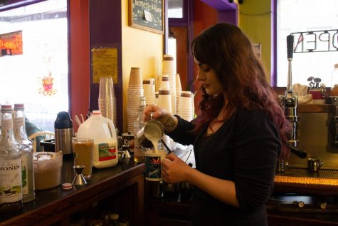 Arielle Miller is a barista at Interzone on Monroe Avenue, which just celebrated its 20th birthday.