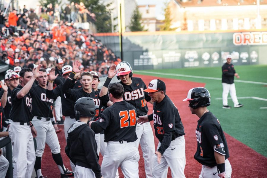 OSU+teammates+congratulate+redshirt+senior+outfielder+Kyle+Nobach+during+the+first+of+three+games+on+Friday+against+Stanford.+The+Beavers+walked+away+with+a+6-2+win.