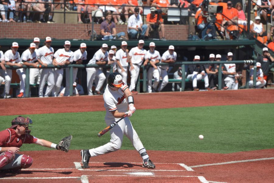 Sophomore catcher Adley Rutschman swings for the ball in the second game of the series on Saturday against Stanford University. Oregon State University won 10-0.