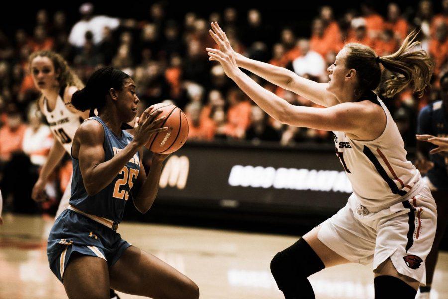 Senior center Marie Gulich guards UCLA's junior forward Monique Billings.