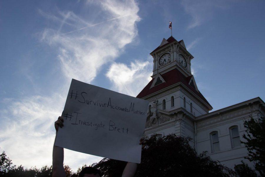 A+protestor+holds+a+sign+aloft.