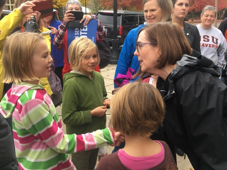 Oregon+Gov.+Kate+Brown%2C+the+states+second+female+governor%2C+greets+voters+and+their+families+during+a+campaign+stop+at+Reser+Stadium+on+Saturday.