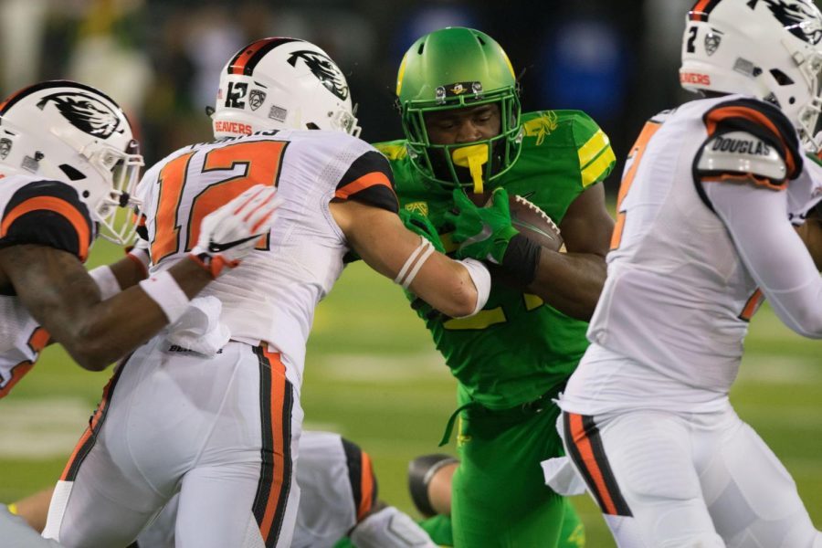 Oregon+running+back+Royce+Freeman+fighting+his+way+through+the+OSU+defense+during+a+previous+Civil+War+match+up.%C2%A0