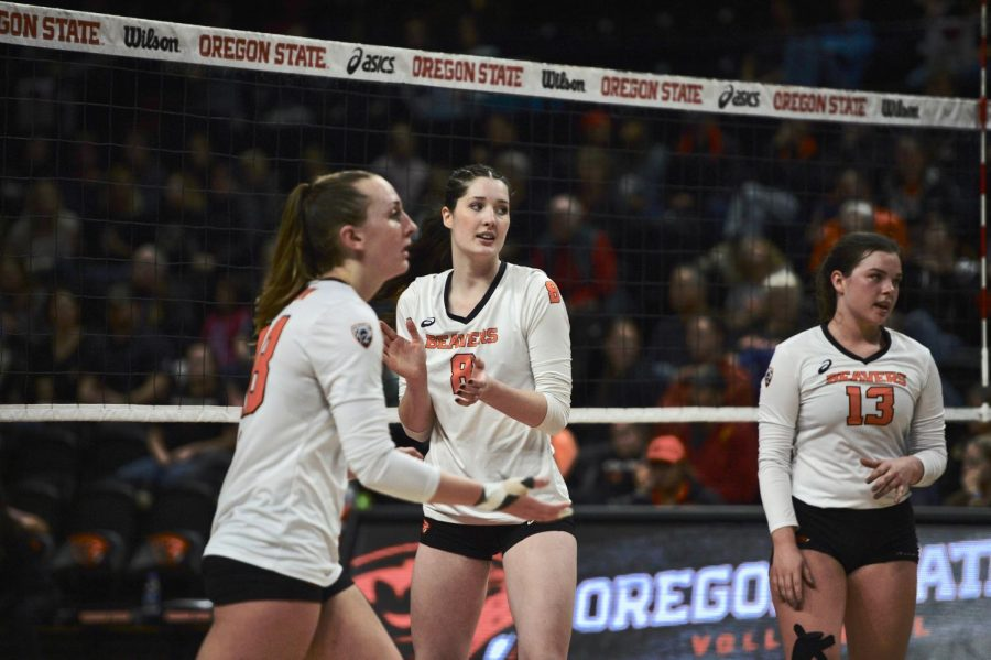 (LEFT TO RIGHT) Junior outside hitter Amy Underdown, senior middle blocker Maddy Gravley and freshman setter Maddie Sheehan all start walking to the huddle after Utah gains a point.