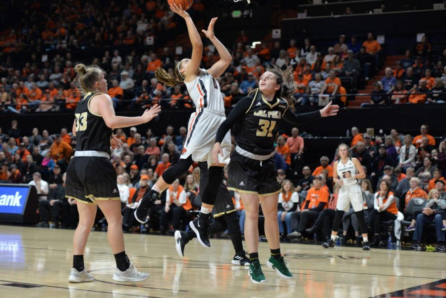 Junior point guard Mikayla Pivec goes up hard for the lay up. Pivec scored 15 points on the night, helping the Beavers to a victory in their home opener at Gill Coliseum.