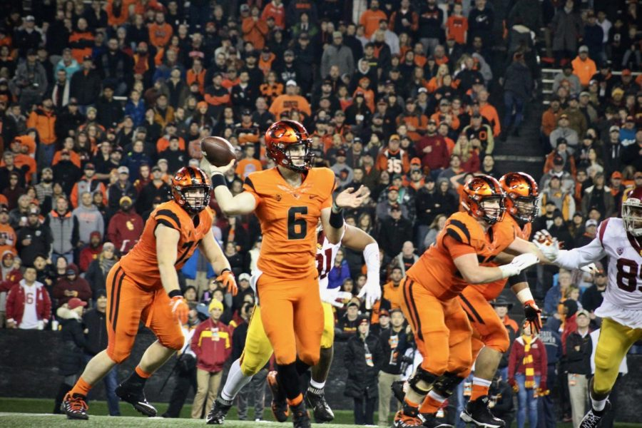 OSU+senior+quarterback+Jake+Luton+prepares+to+throw+the+pass+downfield+after+rolling+out+to+his+right.+Luton%C2%A0threw+for+301+yards+and+one+touchdown+on+the+night.