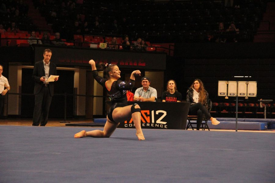 OSU+freshman+all-around+Kristina+Peterson+performs+her+floor+routine+in+front+of+the+fans+and+judges.+Her+performance+was+largely+inspired+by+the+Austin+Powers+films.%C2%A0