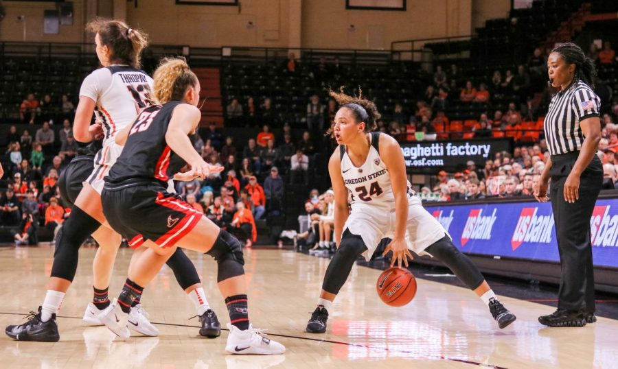 OSU+redshirt+sophomore+guard+Destiny+Slocum+being+guarded+by+NNU+forward+Erin+Jenkins.+Slocum+tallied+up+11+points+on+the+night+including+a+three+point+shot+just+before+the+halftime+buzzer.%C2%A0