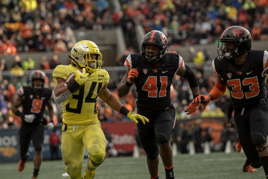 Oregon running back rushes down the sideline as part of his four touchdown performance in the 122nd Civil War matchup.