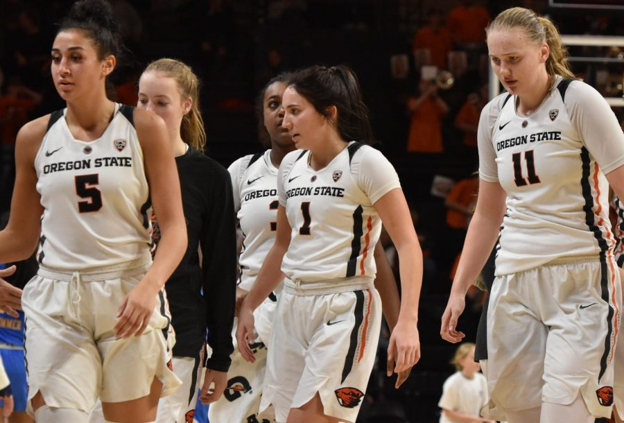 OSU+sophomore+Aleah+Goodman+%28Middle%29+and+Taya+Corosdale+%28Left%29+walk+to+the+bench+with+senior+center+Joanna+Grymek.+Goodman+led+the+Beavers+in+scoring+with+21+points+to+help+OSU+take+down+UCLA+with+a+final+score+of+75-72.