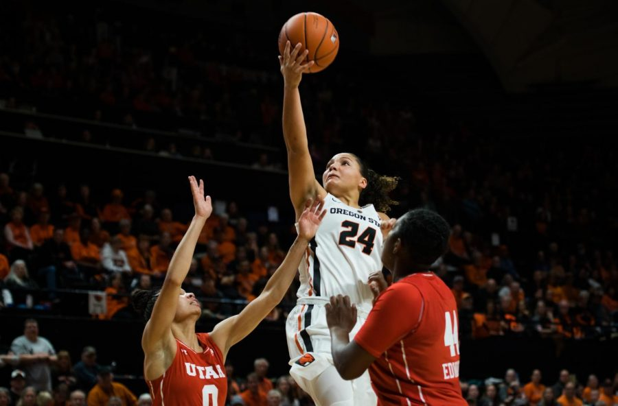 OSU+sophomore+guard+Destiny+Slocum+goes+high+for+the+lay+up+over+two+Utah+defenders.+Slocum+helped+the+Beavers+earn+the+71-63+win+over+the+Utes+by+scoring+20+points%2C+five+assists+and+three+steals+on+the+night.