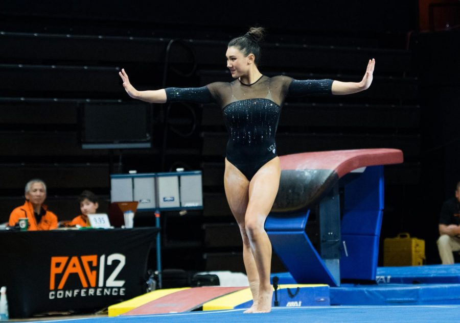 UCLA+all-arounder+Kyla+Ross%2C+an+olympic+gold+medalist%2C+performs+her+signature+floor+routine+in+front+of+a+packed+Gill+Coliseum+crowd.+Ross+highlight+of+the+night+came+on+the+uneven+bars+when+she+tallied+a+perfect+10.00+from+the+judges%2C+helping+UCLA+pull+away+with+the+win.