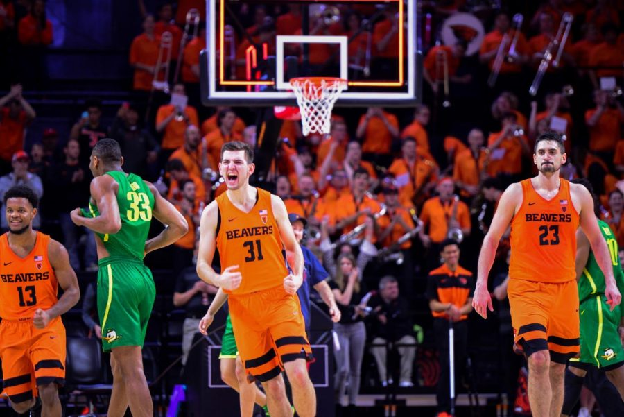 OSU+freshman+Eli+Glenzel+celebrates+the+win+over+Oregon+after+the+clock+hits+zero.+Glenzel+got+onto+the+court+for+the+first+time+in+his+career+in+Saturday%2C+recording+a+rebound+in+his+12+seconds+of+play.%C2%A0