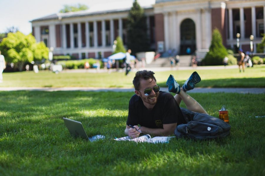 Second-year+ecological+engineering+student+Dan+Hofmann+prepares+for+summer+courses+outside+the+Memorial+Union.%C2%A0