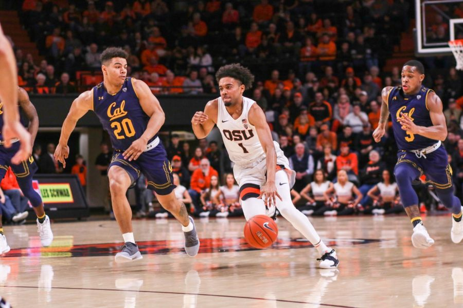 OSU senior guard Stephen Thompson Jr. (MIDDLE) leads his team in a fast break against California forward Matt Bradley (LEFT). Thompson Jr. scored 21 points to help the Beavers secure the 79-71 victory, as well as two assists and two steals.