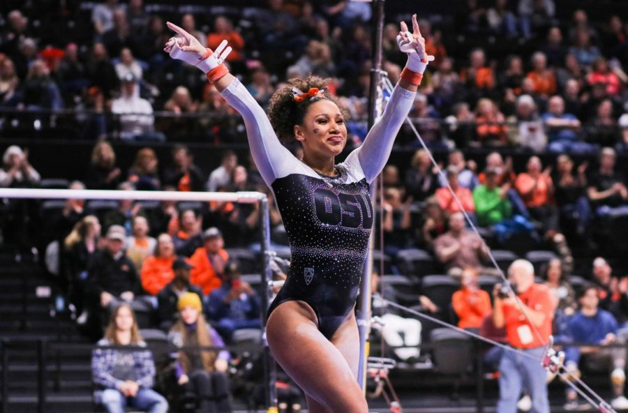 OSU+junior+Isis+Lowery+ends+her+bars+routine+with+hands+in+the+air+as+she+stuck+the+landing+from+the+high+bar.%C2%A0