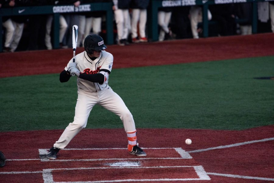 OSU+junior+catcher+and+infielder+Adley+Rutschman+looks+a+low+pitch+past+the+home+plate+against+Oregon.