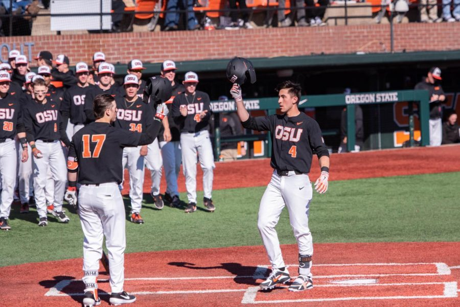 OSU+junior+infielder+Beau+Philip+%28Right%29+taps+hats+with+sophomore+catcher+Troy+Claunch+%28Left%29+after+hitting+his+first+of+two+home+runs+on+the+day.%C2%A0